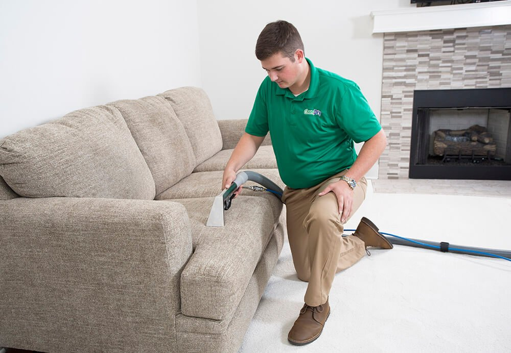 CJ's Chem-Dry tech performing upholstery cleaning in brooklyn park