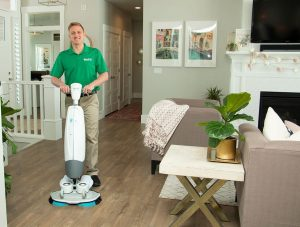 Chem-Dry tech performing wood floor cleaning in Lakewood, CA