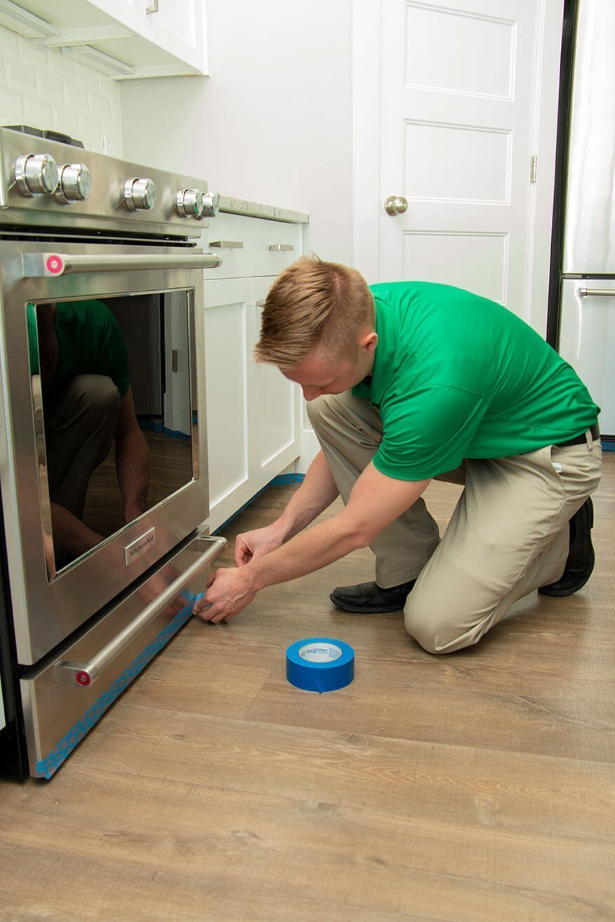 technician preparing for wood floor cleaning in hennepin county home